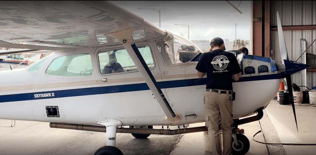 Aircraft technician preforming aircraft maintenance